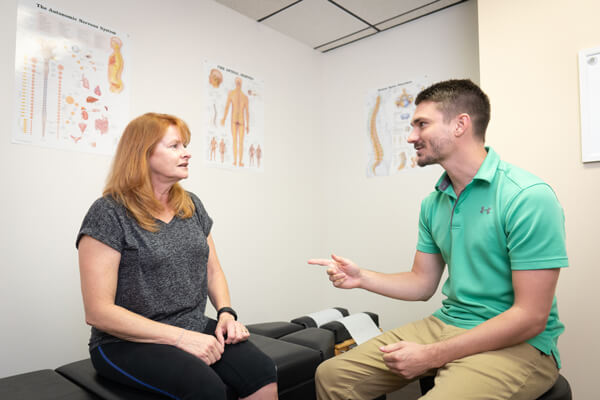 Dr. Eric with woman patient